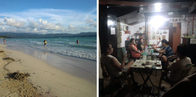 Limited tourism on Boracay Island has returned, as seen here with people swimming on White Beach and eating at a restaurant.