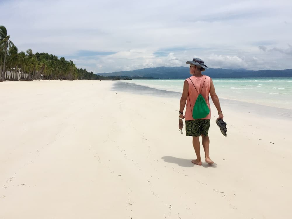 tedly on white sand beach on boracay island