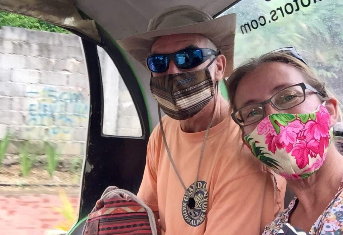 tedly and ellen wear masks on a trike ride
