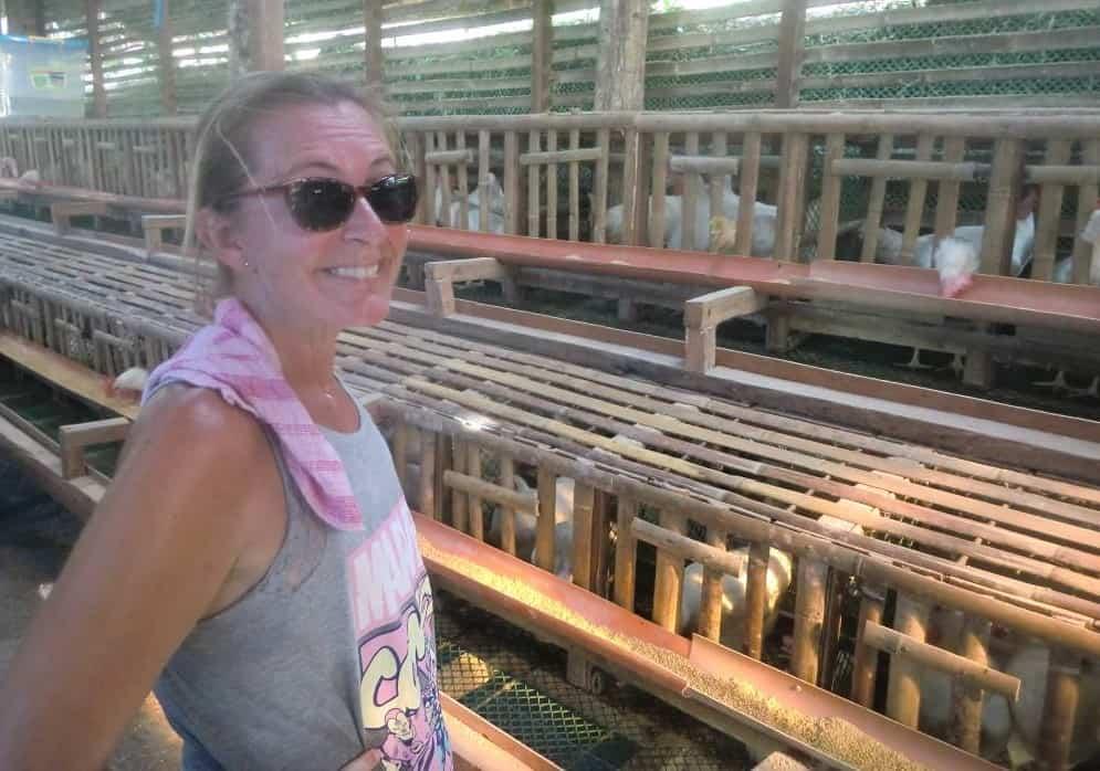 Ellen smiles inside the rebuilt Ati henhouse on mainland Malay in the Philippines.