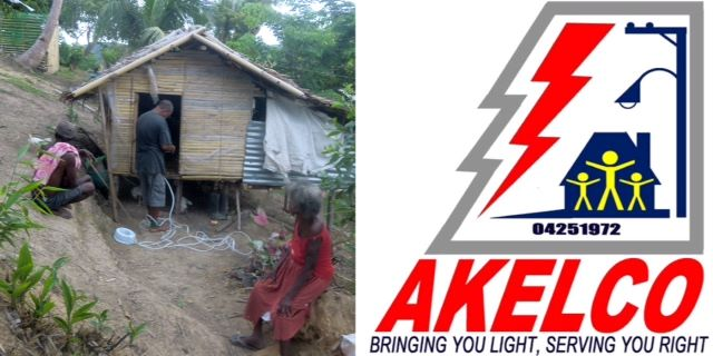 Ati members wire their nipa-hut home for electric service.