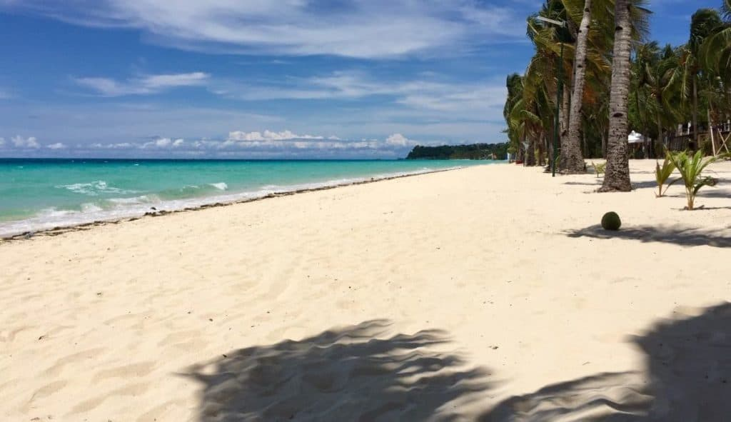 Boracay Island is open to domestic tourists, but its famous White Beach was still virtually empty on the soft opening day.