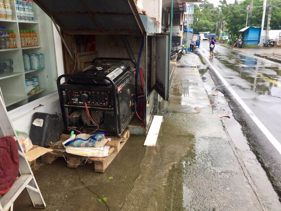 A generator gives power to the Mercury Drug store in Caticlan, Philippines, during Typhoon Quinta.