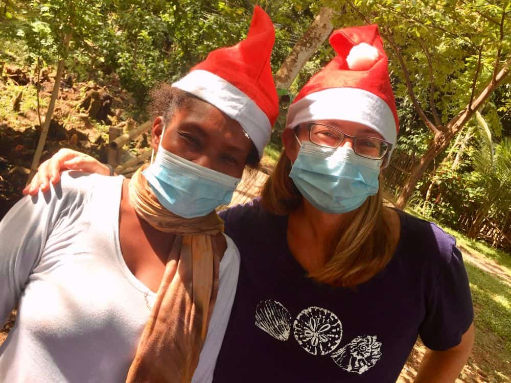 Gilda and Ellen smile after the early Christmas delivery for the Ati tribe in Malay, Aklan, Philippines.
