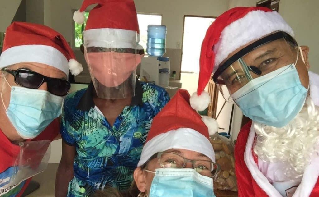 Left to right: Theo, Ati Chief Ernesto, Ellen, Santa Claus.