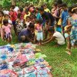 An early Christmas delivery for Ati children included much-needed flip flops - many children arrived barefoot.