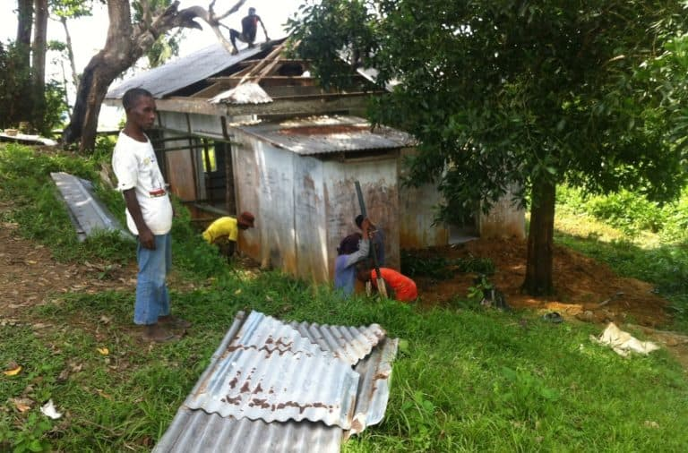 Ati workers in Malay, Aklan, Philippines, working on a roof repair job sponsored by Earth Vagabonds and overseas donors.