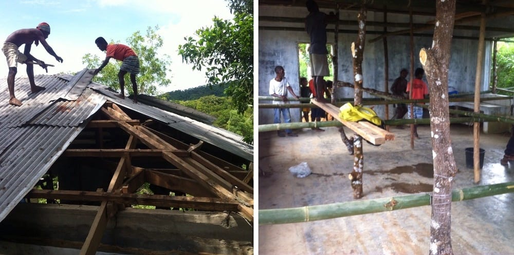 Ati tribe members work on the roof at the only concrete building in the hilltop village.