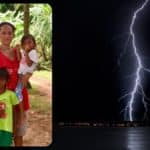 A woman whose husband was killed by lightning as they fished holds her children in sitio Nasuug, Baybay, in Malay, Aklan, Philippines.