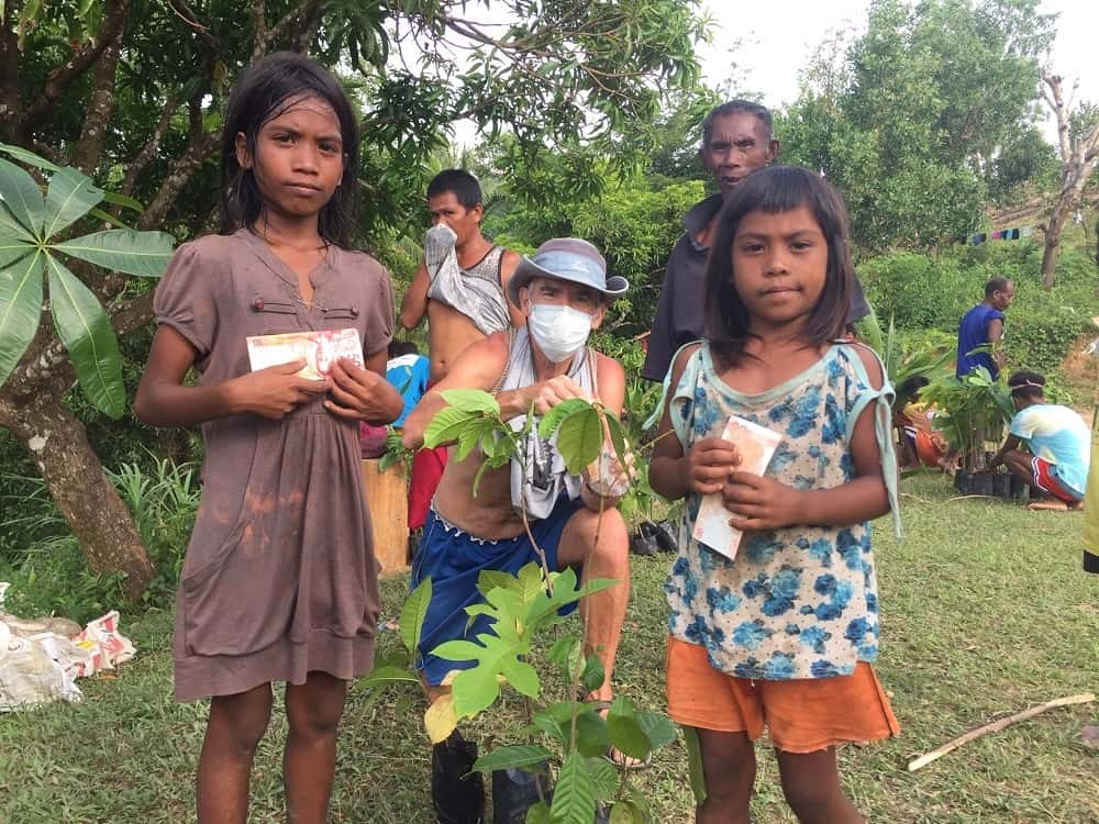 Ati kids get paid for carrying tree seedlings to Kurong Village in Malay, Aklan, Philippines.