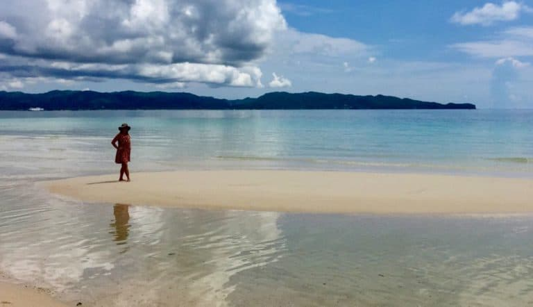 Ellen stands on a tidal sand bar on Boracay Island in the Philippines.